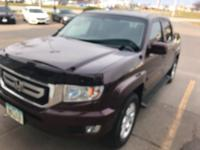 This 2009 Honda Ridgeline RTS is offered to you for