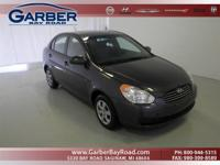 Options Included: N/A2009 Hyundai Accent GLS and Black