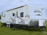 is a single slide fifth wheel that has a rear kitchen,