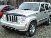 This 2009 Jeep Liberty has alloy wheels, keyless entry,