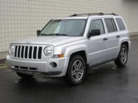 You are looking at a Silver, 2009  Jeep Patriot. This