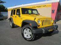 One sharp looking, low mileage yellow Wrangler X! Comes