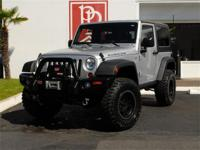 This low mile, 1-owner Wrangler Rubicon has been loaded