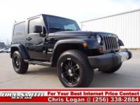 This is one Sharp Jeep Wrangler Sahara 4x4!! It was