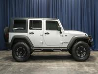 4x4 SUV with Premium Wheels!  Options:  Rear