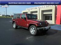 This commanding 2009 Wrangler Unlimited Sahara with its