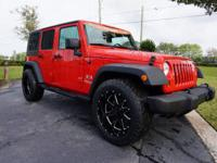 This 2009 Jeep Wrangler Unlimited is featured in Red .