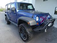 Look at this 2009 Jeep Wrangler Unlimited X. Its