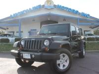 This 2009 Jeep Wrangler Unlimited X is one awesome