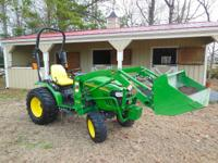 2009 John Deere 2520 4WD HST and three 75 pound weights