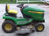 2009 John Deere X320, 143 hours, 48 inch mowing deck,
