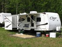Length: 30 feet Year: 2009 Make: Keystone Model: Cougar