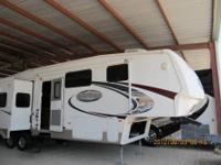 RV Type: Fifth Wheel Year: 2009 Make: Keystone Model: