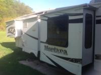 2009 37 ft Montana 5th wheel with 4 Remote slides. No