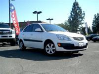 This 2009 Kia Rio 4dr 4dr Sdn Auto LX Sedan features a