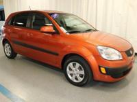 2009 Kia Rio5 LX in Orange... 5-Speed Manual with
