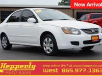 This 2009 Kia Spectra EX in White features. Southern