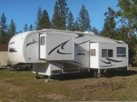 2009 Komfort M-292FS . Like new used only one summer. -