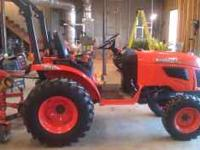 2009 Kubota 2320 with bushhog and finishing mower. Only