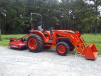 2009 KUBOTA 4X4 TRACTOR WITH LA514 QUICK ATTACH LOADER