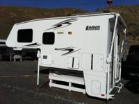 2009 Lance 861 slide-out truck camper for heavy-duty