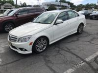 4MATIC and Navigation System. Low miles indicate the