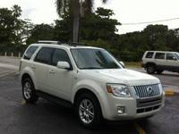 MERCURY MARINER PREMIER..LOW LOW MILES. 17k CAR IS LIKE