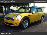 This lovely Mellow Yellow Cooper Clubman certifies for