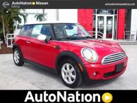 2009 MINI COOPER IS IN CHILLI RED COLOR MANUAL
