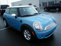 This Blue 2009 MINI Cooper is powered by a 1.6L 4 cyls