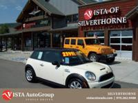 This 2009 Mini Cooper has a clean Carfax and is Vista