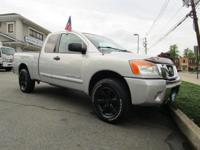 Radiant Silver 2009 Nissan Titan LE 4WD 5-Speed