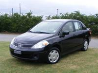 This 2009 Nissan Versa 1.8 S is offered exclusively by