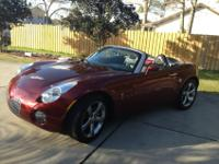 COLOR: Red. 2009 PONTIAC SOLSTICE 2DR CONV. Millage