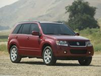Sandstorm Metallic 2009 Suzuki Grand Vitara Luxury 4WD