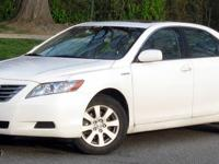 2009 Toyota Camry Hybrid with 42,00 miles. Plus 'Peace