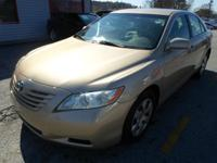 2009 TOYOTA CAMRY LE BROWN ON BEIGE AUTOMATIC WITH ONLY