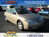 This 2009 Toyota Camry LE in Desert Sand Mica is well