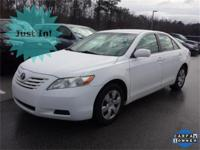 Options:  2009 Toyota Camry Le|White|This Vehicle Is