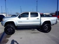 This 2009 Toyota Tacoma has a 6in lift with lifted with