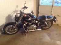 2009 Triumph America with ~4200 miles. Black in Color