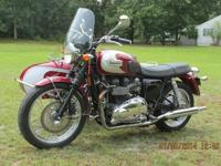 2009 triumph t-100 in excellent condition in claret red