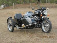 2009 Triumph Thruxton with a lowered sidecar for sale.
