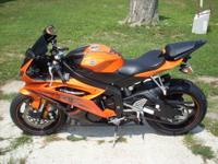 I have a 2009 Vivid Orange R6 with 2578 miles on the