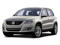 2009 Volkswagen Tiguan S Deep Black Metallic over Brown