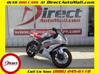 Exterior Color: White. Interior Color: Red. Drivetrain: