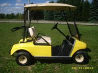 This is a 2009 Club Car Ds with windshield and new