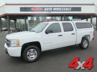 From mountains to mud, this White 2009 Chevrolet