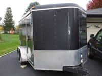 Enclosed trailer, dual axel, V Nose, rear ramp, side