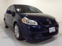 This outstanding example of a 2009 Suzuki SX4 LOW MILES